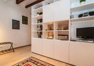 COSY NEST APARTMENT, the bookshelf separating the living area from the sleeping area