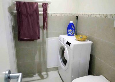 COSY NEST APARTMENT, the washing machine
